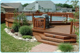 aboveground share deck attached to house, utilizing wood fencing