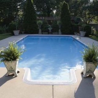 Vacuuming clears dirt and debris from the base of in-ground pools.