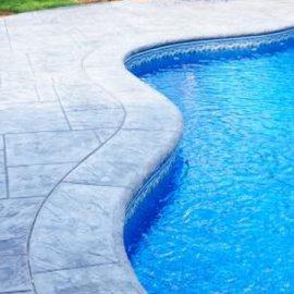 Vacuuming assists a sand filter keep pool water clean.