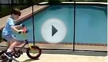 Boy Rides His Bike into Pool Fence