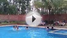 England lady enjoying swimming pool ball game at coorg