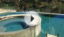 Frameless glass pool fence and glass deck railing